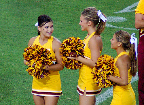 a picture of three asu cheerleaders from 2007